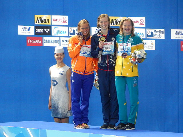 """""""Kazan 2015 - Victory Ceremony 400m freestyle W"""" by Chan-Fan - Own work. Licensed under CC BY-SA 4.0 via Commons."""
