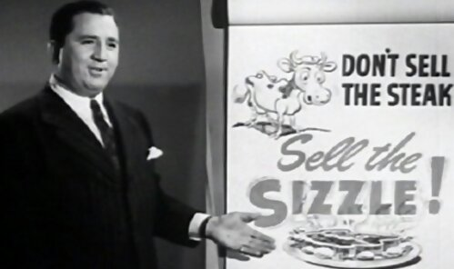 Don't be fooled and overlook this old, simple looking video.  This man is a famous salesman and copywriter.  Back in the day, he made Woolworths millions with his advice.  Elmer Wheeler - Don't Sell The Steak, Sell the Sizzle